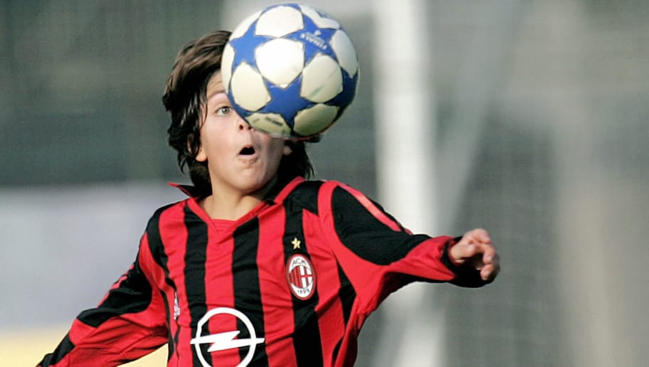 Milan, ITALY:  Junior AC Milan's Christian Maldini, the eight-year-old son of Italian soccer ace Paolo Maldini, controls the ball during a match with team's juvenile squad, in Milan, 29 October 2005. Following in the footsteps of his  father Paolo and his grandfather Cesare , Christian  is the family's third generation to wear the AC Milan jersey.   AFP PHOTO / Filippo MONTEFORTE  (Photo credit should read FILIPPO MONTEFORTE/AFP/Getty Images)
