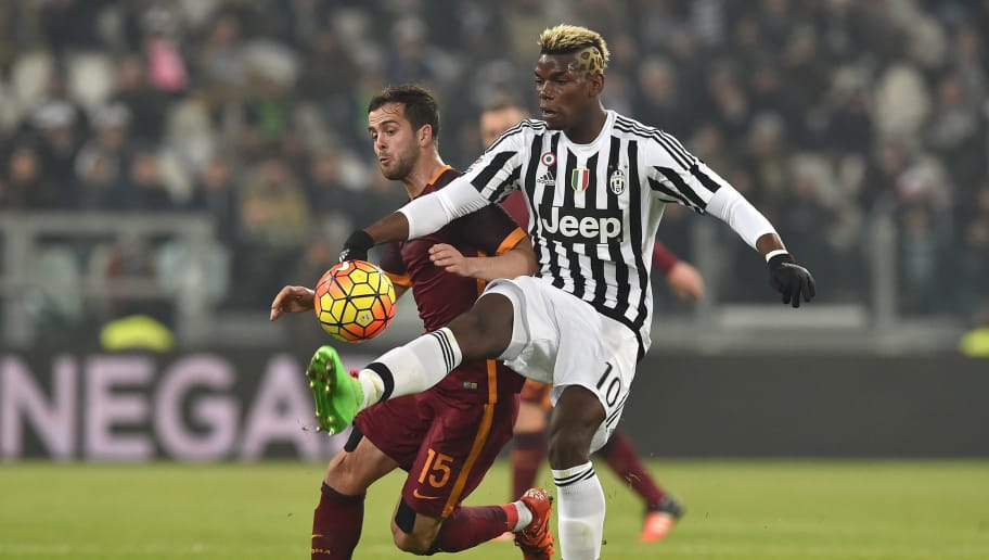 TURIN, ITALY - JANUARY 24:  Paul Pogba (R) of Juventus FC competes with Miralem Pjanic of AS Roma during the Serie A match between Juventus FC and AS Roma at Juventus Arena on January 24, 2016 in Turin, Italy.  (Photo by Valerio Pennicino/Getty Images)
