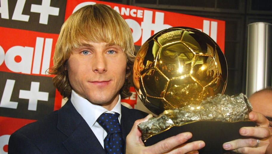 PARIS, FRANCE:  Juventus midfielder Pavel Nedved poses, 22 December 2003 in Paris, with the Ballon d'Or, prize handed out by bi-weekly France Football magazine for the 2003 European Footballer of the Year. Nedved captained Czech Republic to the Euro 2004 finals in Portugal and last season led Juventus to the Champions League final, where they lost to AC Milan on penalties, though he was suspended for that match at Old Trafford.  AFP PHOTO  PIERRE VERDY  (Photo credit should read PIERRE VERDY/AFP/Getty Images)