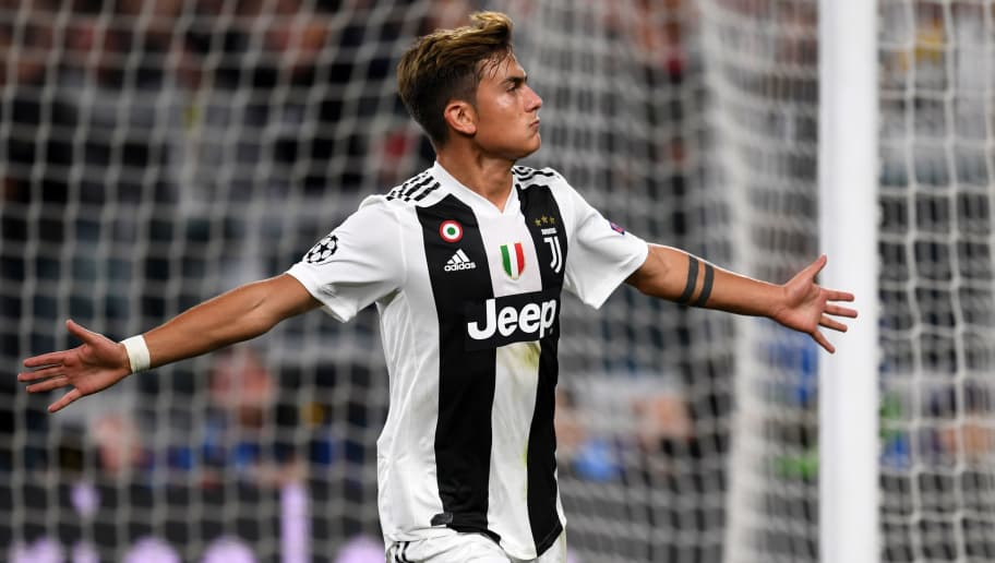 TURIN, ITALY - OCTOBER 02:  Paulo Dybala of Juventus celebrates scoring his side's second goal  during the Group H match of the UEFA Champions League between Juventus and BSC Young Boys at  on October 2, 2018 in Turin, Italy.  (Photo by Etsuo Hara/Getty Images)