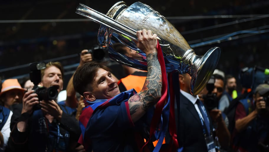 BERLIN, GERMANY - JUNE 06:  Lionel Messi of Barcelona celebrates with the trophy after the UEFA Champions League Final between Juventus and FC Barcelona at Olympiastadion on June 6, 2015 in Berlin, Germany.  (Photo by Laurence Griffiths/Getty Images)
