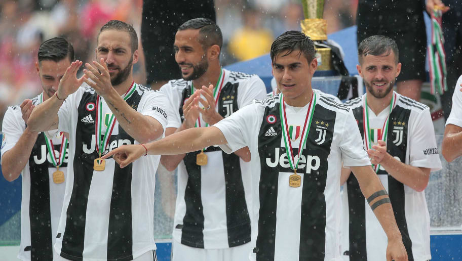 TURIN, ITALY - MAY 19:  Paulo Dybala of Juventus FC celebrates with his teammates after winning the Serie A Championship at the end of the serie A match between Juventus and Hellas Verona FC at Allianz Stadium on May 19, 2018 in Turin, Italy.  (Photo by Emilio Andreoli/Getty Images)