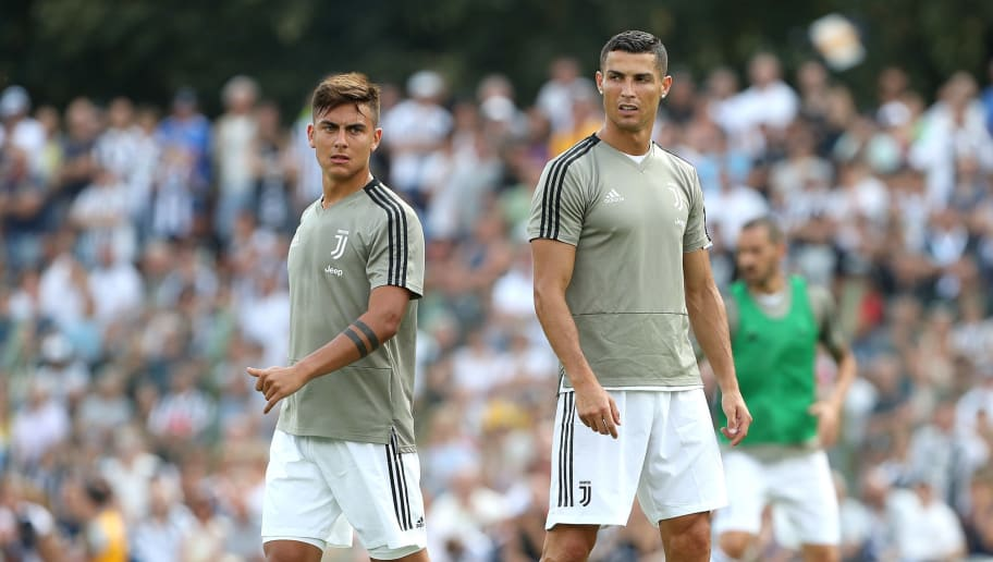 VILLAR PEROSA, ITALY - AUGUST 12:  Paulo Dybala and Cristiano Ronaldo of Juventus during the warm up prior to the Pre-Season Friendly match between Juventus and Juventus U19 on August 12, 2018 in Villar Perosa, Italy.  (Photo by Marco Luzzani/Getty Images)