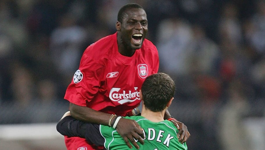 TURIN, ITALY - APRIL 13:  Jerzy Dudek and Djimi Traore of Liverpool celebrate victory over Juventus after the UEFA Champions League quarter-final second leg between Juventus and Liverpool at the Delle Alpi Stadium on April 13, 2005 in Turin, Italy. (Photo by Mike Hewitt/Getty Images)