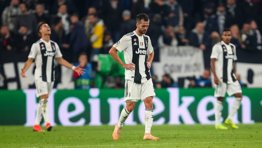 TURIN, ITALY - NOVEMBER 07: A dejected Miralem Pjanic of Juventus after conceding a goal to make it 1-2 during the Group H match of the UEFA Champions League between Juventus and Manchester United at  on November 7, 2018 in Turin, Italy. (Photo by Robbie Jay Barratt - AMA/Getty Images)