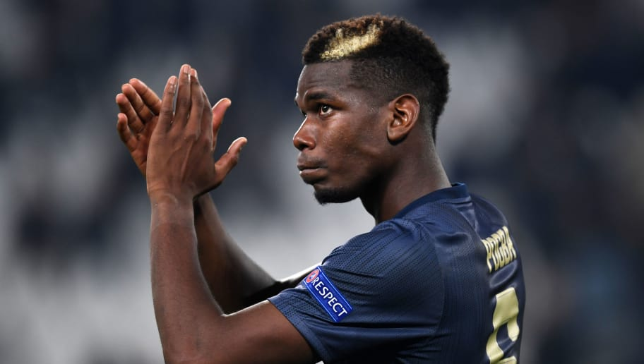 TURIN, ITALY - NOVEMBER 07: Paul Pogba of Manchester United applauds fans after the Group H match of the UEFA Champions League between Juventus and Manchester United at  on November 07, 2018 in Turin, Italy. (Photo by Etsuo Hara/Getty Images)