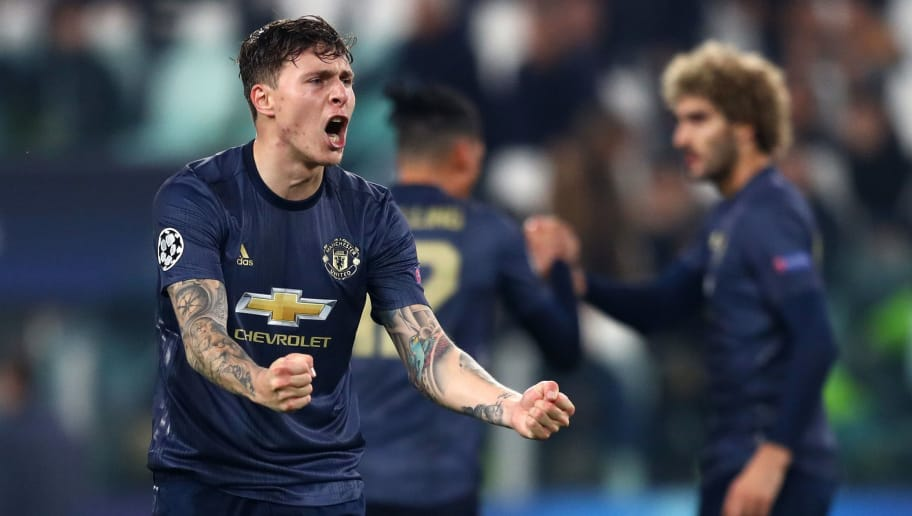 TURIN, ITALY - NOVEMBER 07:  Victor Lindelof of Manchester United celebrates at the full time whistle after the UEFA Champions League Group H match between Juventus and Manchester United at Juventus Stadium on November 7, 2018 in Turin, Italy.  (Photo by Michael Steele/Getty Images)
