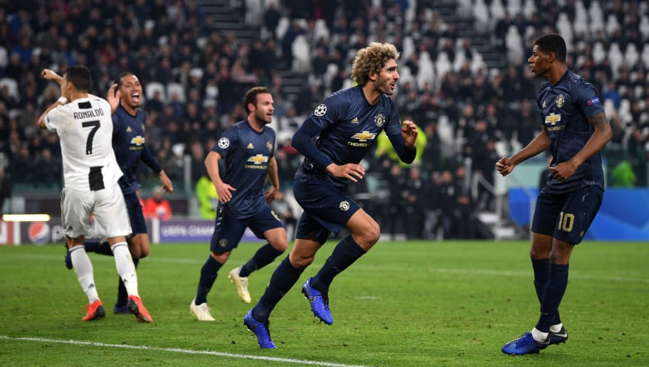 TURIN, ITALY - NOVEMBER 07:  Marouane Fellaini of Manchester United celebrates his sides second goal which came through a Alex Sandro of Juventus (not pictured) own goal during the UEFA Champions League Group H match between Juventus and Manchester United at Juventus Stadium on November 7, 2018 in Turin, Italy.  (Photo by Shaun Botterill/Getty Images)