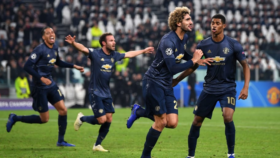 TURIN, ITALY - NOVEMBER 07:  Marouane Fellaini of Manchester United celebrates his sides second goal which came through a Alex Sandro of Juventus (not pictured) own goal with Marcus Rashford of Manchester United during the UEFA Champions League Group H match between Juventus and Manchester United at Juventus Stadium on November 7, 2018 in Turin, Italy.  (Photo by Shaun Botterill/Getty Images)