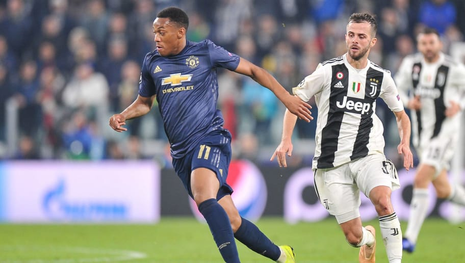 TURIN, ITALY - NOVEMBER 07: Anthony Martial of Manchester United competes with Miralem Pjanic of Juventus FC during the Group H match of the UEFA Champions League between Juventus and Manchester United at Juventus Stadium on November 7, 2018 in Turin, Italy. (Photo by Norbert Barczyk/PressFocus/MB Media/Getty Images)