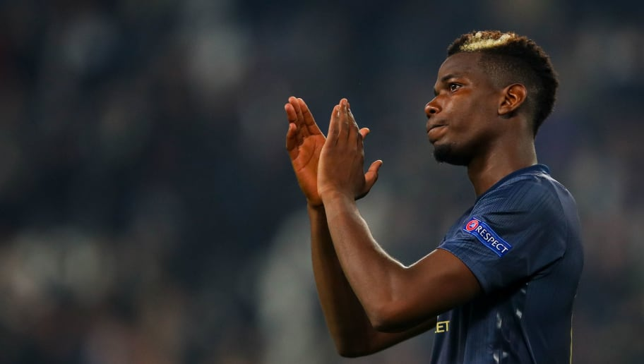 TURIN, ITALY - NOVEMBER 07: Paul Pogba of Manchester United applauds the fans at full time during the Group H match of the UEFA Champions League between Juventus and Manchester United at  on November 7, 2018 in Turin, Italy. (Photo by Robbie Jay Barratt - AMA/Getty Images)