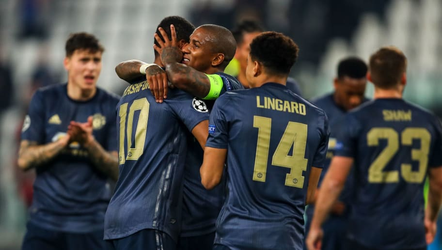 TURIN, ITALY - NOVEMBER 07: Ashley Young of Manchester United and Marcus Rashford of Manchester United celebrate at full time during the Group H match of the UEFA Champions League between Juventus and Manchester United at  on November 7, 2018 in Turin, Italy. (Photo by Robbie Jay Barratt - AMA/Getty Images)