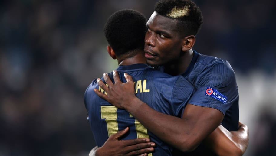 TURIN,ITALY - NOVEMBER 7: Paul Pogba (R) and Anthony Martial of Manchester United celebrate their victory after during the Group H of the UEFA Champions League between Juventus and Manchester United at Juventus Stadium on November 07, 2018 in Turin, Italy. (Photo by Etsuo Hara/Getty Images)