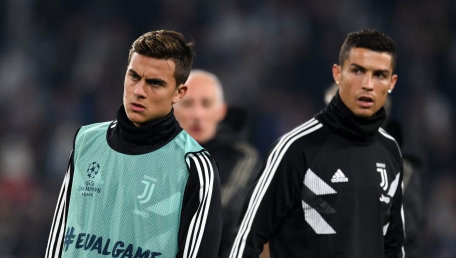 TURIN,ITALY - NOVEMBER 7: Paulo Dybala (L) and Cristiano Ronaldo of Juventus look on prior to the Group H match of the UEFA Champions League between Juventus and Manchester United at Juventus Stadium on November 07, 2018 in Turin, Italy. (Photo by Etsuo Hara/Getty Images)