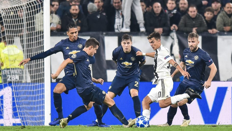 TURIN, ITALY - NOVEMBER 07: Paulo Dybala of Juventus FC competes with Chris Smalling of Manchester United and Nemanja Matic of Manchester United during the Group H match of the UEFA Champions League between Juventus and Manchester United at Juventus Stadium on November 7, 2018 in Turin, Italy. (Photo by Lukasz Laskowski/PressFocus/MB Media/Getty Images)