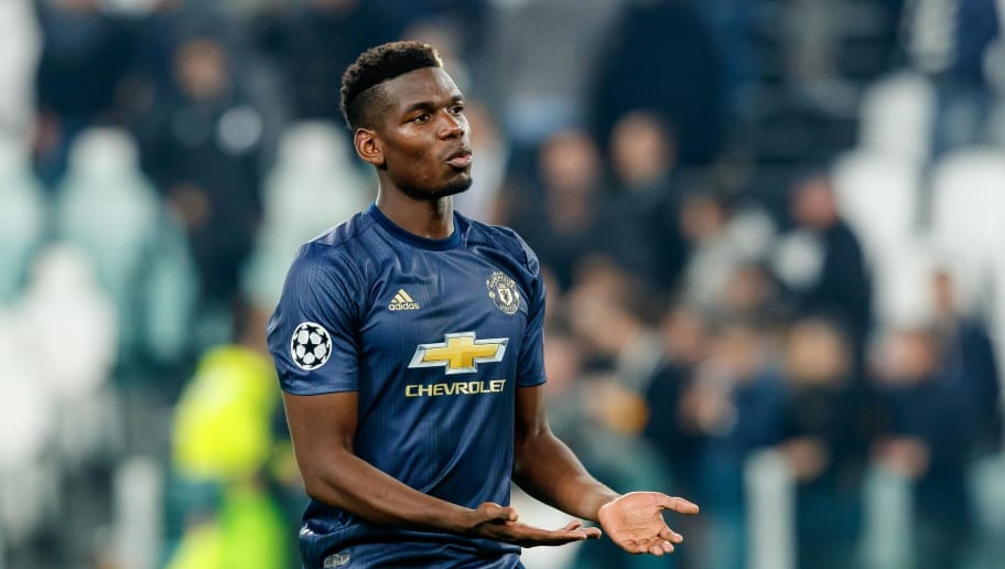 TURIN, ITALY - NOVEMBER 07: Paul Pogba of Manchester United looks on during the Group H match of the UEFA Champions League between Juventus and Manchester United at  on November 7, 2018 in Turin, Italy. (Photo by TF-Images/Getty Images)