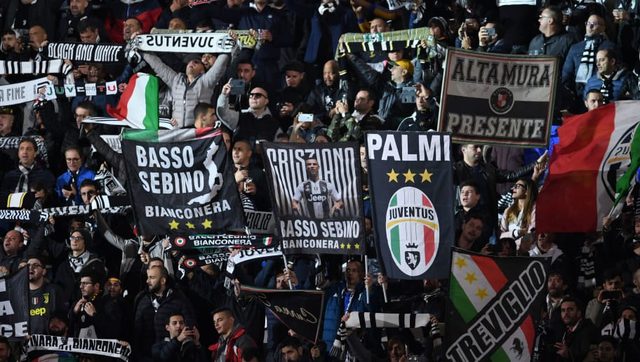 TURIN,ITALY - NOVEMBER 7: Fans of Juventus cheer prior to the Group H match of the UEFA Champions League between Juventus and Manchester United at Juventus Stadium on November 07, 2018 in Turin, Italy. (Photo by Etsuo Hara/Getty Images)