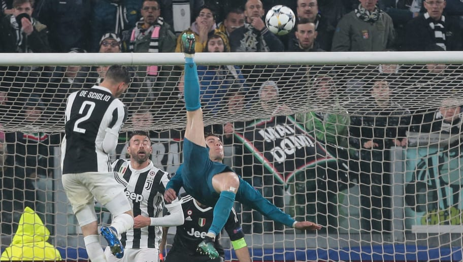 TURIN, ITALY - APRIL 03:  Cristiano Ronaldo of Real Madrid scores his sides second goal during the UEFA Champions League Quarter Final Leg One match between Juventus and Real Madrid at Allianz Stadium on April 3, 2018 in Turin, Italy.  (Photo by Emilio Andreoli/Getty Images)