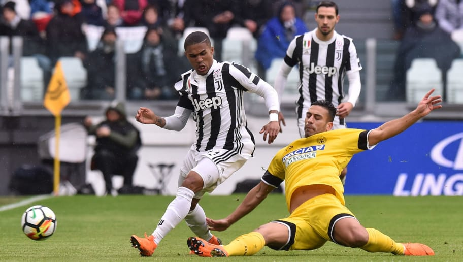 TURIN, ITALY - MARCH 11:  Douglas Costa (L) of Juventus and Ali Adnan of Udinese compete for the ball during the serie A match between Juventus and Udinese Calcio on March 11, 2018 in Turin, Italy.  (Photo by Tullio M. Puglia/Getty Images)