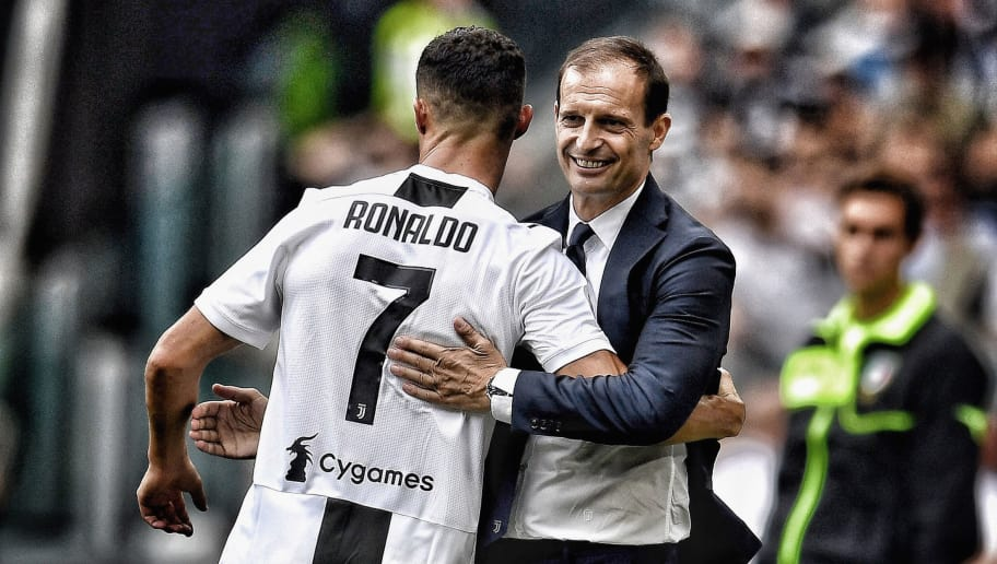 TURIN, ITALY - SEPTEMBER 16:  (EDITORS NOTE: This image was altered using a digital filter) Cristiano Ronaldo of Juventus (L) and head coach Juventus Massimiliano Allegri celebrate after scoring the opening goal during the serie A match between Juventus and US Sassuolo at Allianz Stadium on September 16, 2018 in Turin, Italy.  (Photo by Claudio Villa./Getty Images)