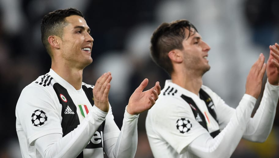 TURIN, ITALY - NOVEMBER 27:  (L- R) Cristiano Ronaldo and Rodrigo Betancur of Juventus celenbrates victory during the Group H match of the UEFA Champions League between Juventus and Valencia at  on November 27, 2018 in Turin, Italy.  (Photo by Pier Marco Tacca/Getty Images)
