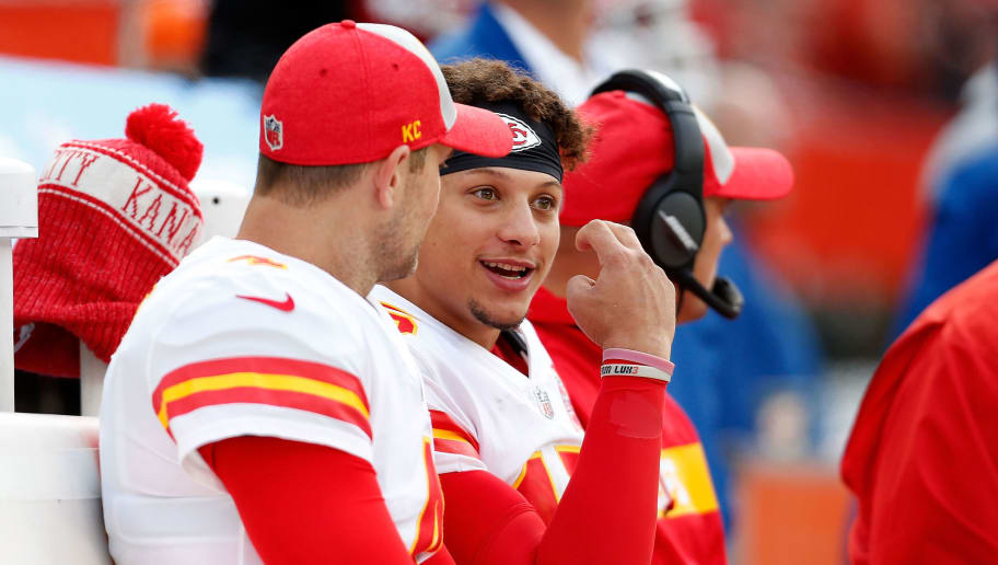 CLEVELAND, OH - NOVEMBER 4:  Patrick Mahomes #15 of the Kansas City Chiefs talks with Chad Henne #4 while sitting on the bench during the game against the Cleveland Brownsat FirstEnergy Stadium on November 4, 2018 in Cleveland, Ohio. (Photo by Kirk Irwin/Getty Images)