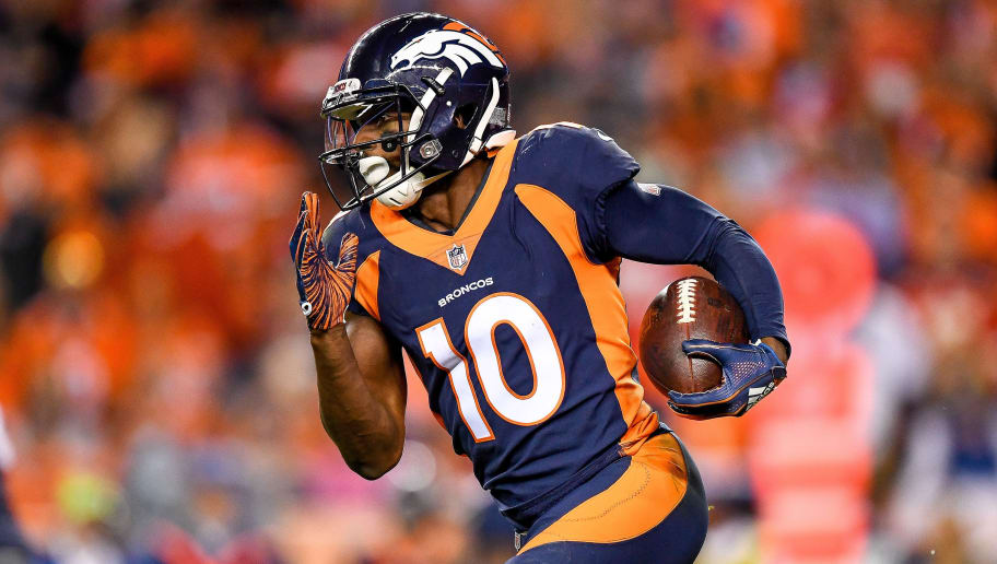 DENVER, CO - OCTOBER 1:  Wide receiver Emmanuel Sanders #10 of the Denver Broncos carries the ball after a reception against the Kansas City Chiefs in the third quarter at Broncos Stadium at Mile High on October 1, 2018 in Denver, Colorado. (Photo by Dustin Bradford/Getty Images)