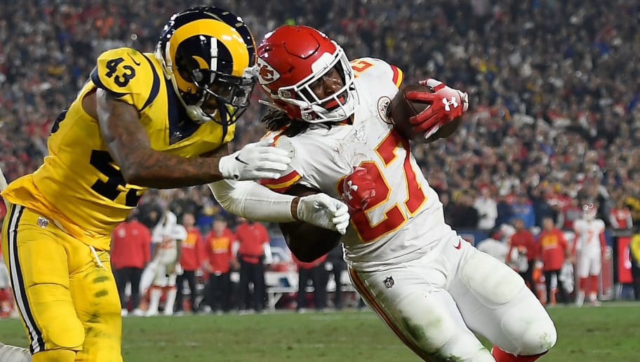 LOS ANGELES, CA - NOVEMBER 19:  John Johnson #43 of the Los Angeles Rams (C) pushes Kareem Hunt #27 of the Kansas City Chiefs (R) short of the end zone and no first down as Cory Littleton #58 (L) watches the play during the second quarter of the game at Los Angeles Memorial Coliseum on November 19, 2018 in Los Angeles, California.  (Photo by Kevork Djansezian/Getty Images)