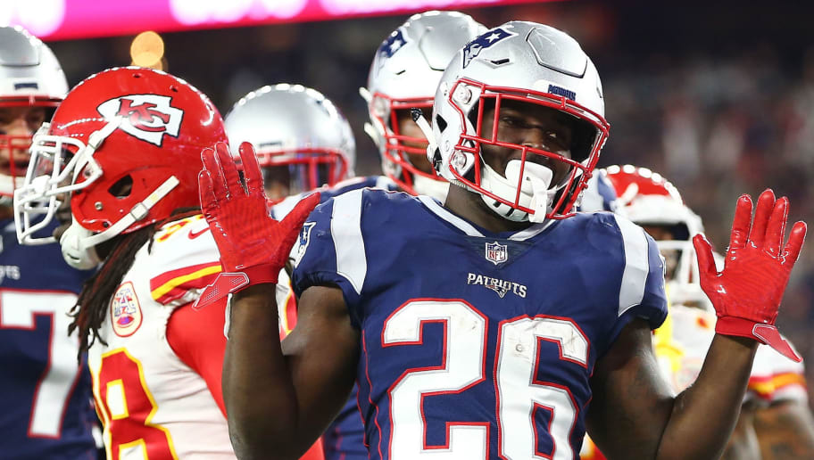 FOXBOROUGH, MA - OCTOBER 14:  Sony Michel #26 of the New England Patriots celebrates afters scoring a touchdown in the first quarter of a game against the Kansas City Chiefs at Gillette Stadium on October 14, 2018 in Foxborough, Massachusetts.  (Photo by Adam Glanzman/Getty Images)