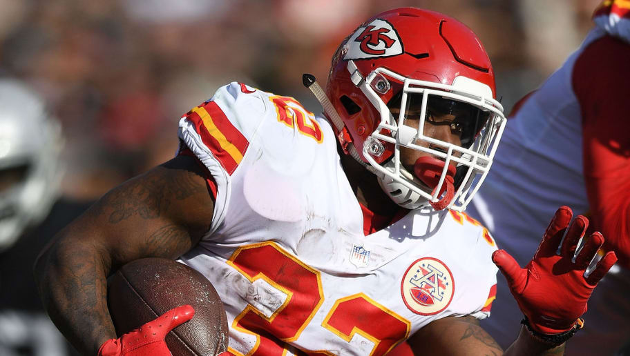 OAKLAND, CA - DECEMBER 02:  Spencer Ware #32 of the Kansas City Chiefs carries the ball against the Oakland Raiders during the first half of an NFL football game at Oakland-Alameda County Coliseum on December 2, 2018 in Oakland, California.  (Photo by Thearon W. Henderson/Getty Images)