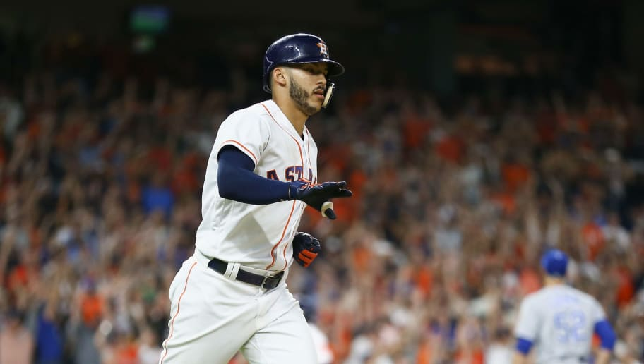 HOUSTON, TX - JUNE 23:  Carlos Correa #1 of the Houston Astros hits a walkoff single in the twelfth inning against the Kansas City Royals for a 4-3 win at Minute Maid Park on June 23, 2018 in Houston, Texas.  (Photo by Bob Levey/Getty Images)