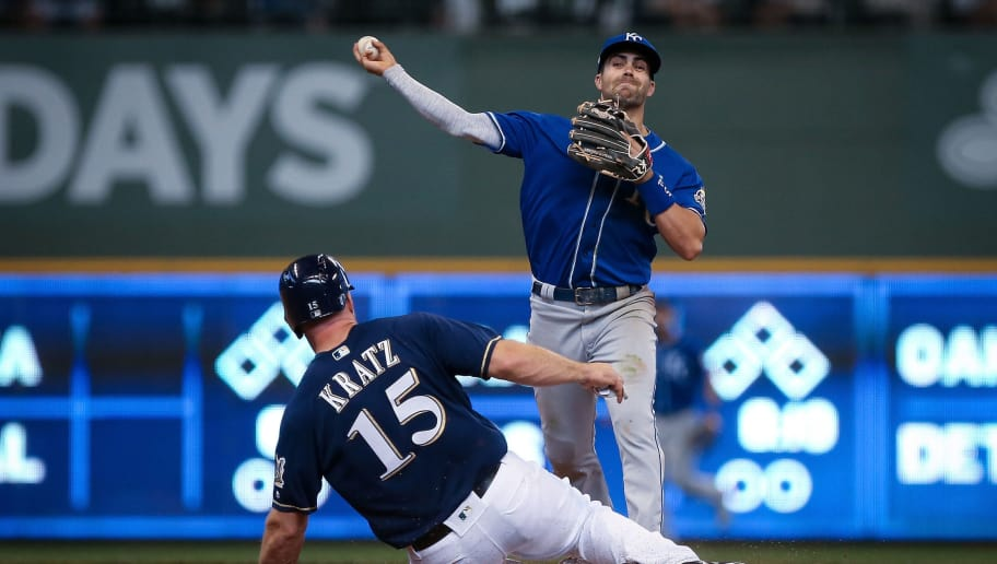 MILWAUKEE, WI - JUNE 27:  Whit Merrifield #15 of the Kansas City Royals turns a double play past Erik Kratz #15 of the Milwaukee Brewers in the ninth inning at Miller Park on June 27, 2018 in Milwaukee, Wisconsin.  (Photo by Dylan Buell/Getty Images)