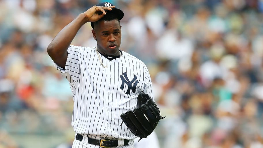 NEW YORK, NY - JULY 28: Luis Severino #40 of the New York Yankees reacts after giving up a 2-run single to Salvador Perez #13 of the Kansas City Royals in the fifth inning at Yankee Stadium on July 28, 2018 in the Bronx borough of New York City.  (Photo by Mike Stobe/Getty Images)