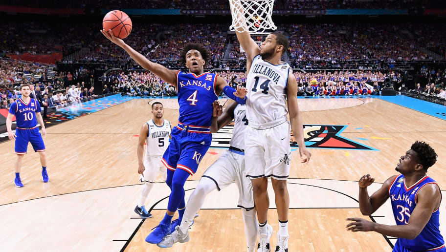 SAN ANTONIO, TX - MARCH 31:  Devonte' Graham #4 of the Kansas Jayhawks shoots against Omari Spellman #14 of the Villanova Wildcats in the first half in the 2018 NCAA Men's Final Four semifinal game at the Alamodome on March 31, 2018 in San Antonio, Texas.  (Photo by Jamie Schwaberow - Pool/Getty Images)