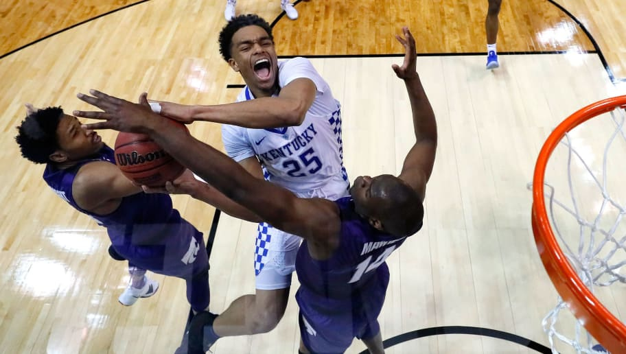 ATLANTA, GA - MARCH 22: PJ Washington #25 of the Kentucky Wildcats goes up with the ball against Amaad Wainright #23 and Makol Mawien #14 of the Kansas State Wildcats in the second half during the 2018 NCAA Men's Basketball Tournament South Regional at Philips Arena on March 22, 2018 in Atlanta, Georgia.  (Photo by Kevin C. Cox/Getty Images)