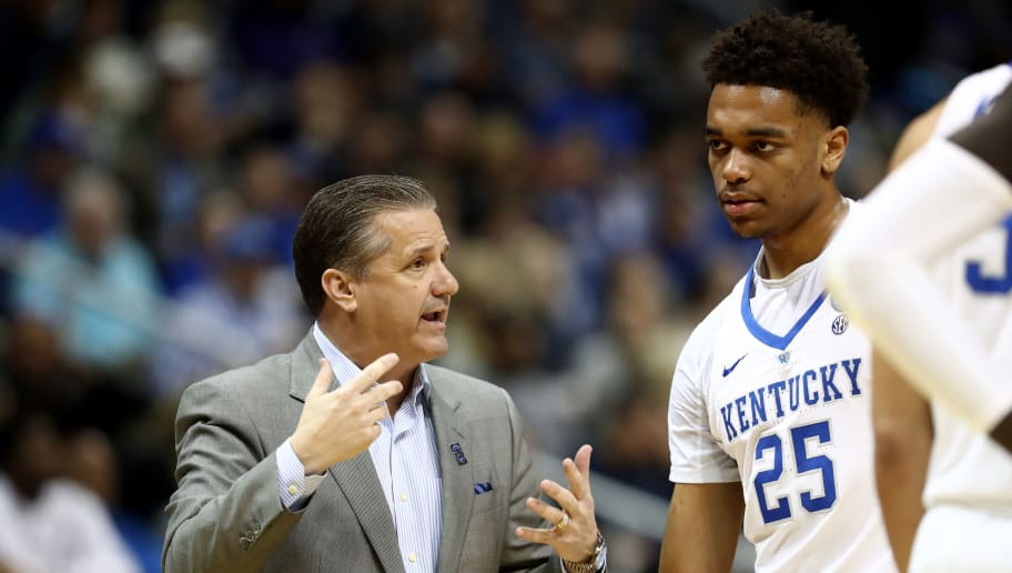 ATLANTA, GA - MARCH 22: Head coach John Calipari of the Kentucky Wildcats speaks to PJ Washington #25 in the first half against the Kansas State Wildcats during the 2018 NCAA Men's Basketball Tournament South Regional at Philips Arena on March 22, 2018 in Atlanta, Georgia.  (Photo by Ronald Martinez/Getty Images)