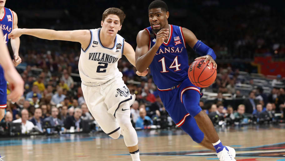 SAN ANTONIO, TX - MARCH 31: Malik Newman #14 of the Kansas Jayhawks is defended by Collin Gillespie #2 of the Villanova Wildcats during the 2018 NCAA Men's Final Four Semifinal at the Alamodome on March 31, 2018 in San Antonio, Texas. The Villanova Wildcats defeated the Kansas Jayhawks 95-79.  (Photo by Ronald Martinez/Getty Images)