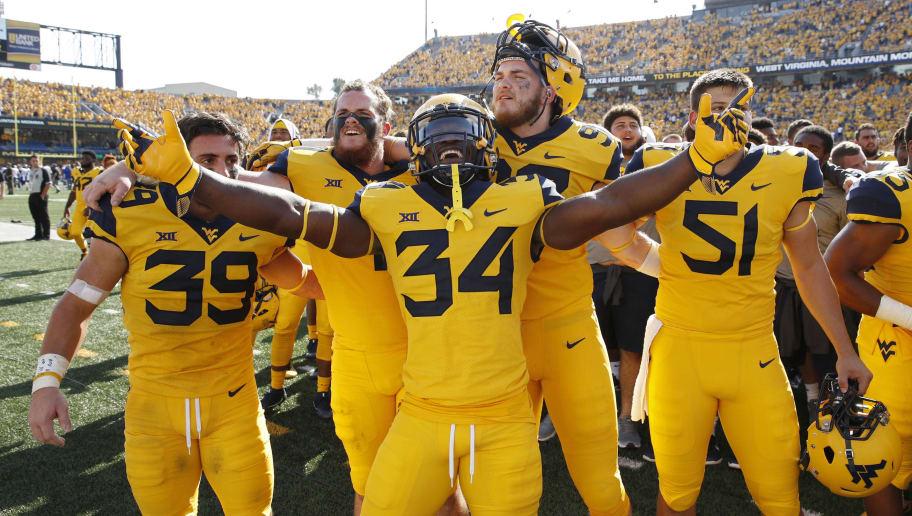 MORGANTOWN, WV - OCTOBER 06: West Virginia Mountaineers players celebrate after the game against the Kansas Jayhawks at Mountaineer Field on October 6, 2018 in Morgantown, West Virginia. The Mountaineers won 38-22. (Photo by Joe Robbins/Getty Images)