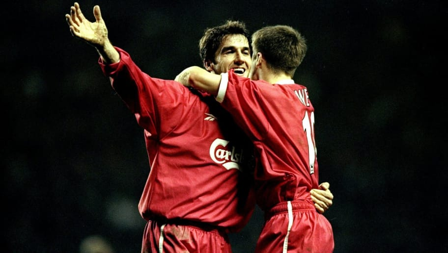 28 Dec 1998: Karl-Heinz Riedle of Liverpool celebrates his goal with Michael Owen during the FA Carling Premiership match against Newcastle United played at Anfield in Liverpool, England.  The match finished in a 4-2 victory for Liverpool. \ Mandatory Credit: Clive Brunskill /Allsport