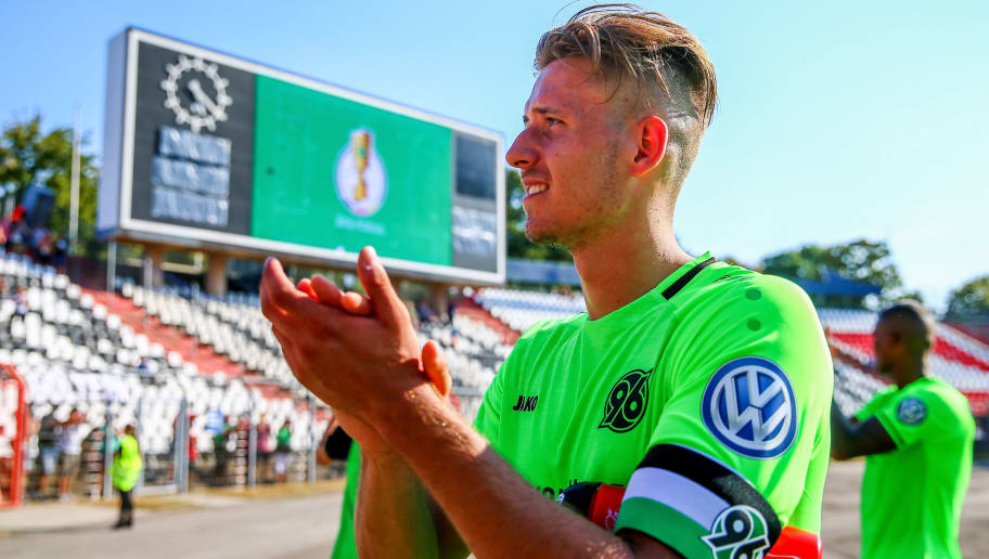 KARLSRUHE, GERMANY - AUGUST 19:  Waldemar Anton of Hannover celebrates after the DFB Cup first round match between Karslruher SC and Hannover 96 at Wildparkstadion on August 19, 2018 in Karlsruhe, Germany.  (Photo by Thomas Niedermueller/Bongarts/Getty Images)