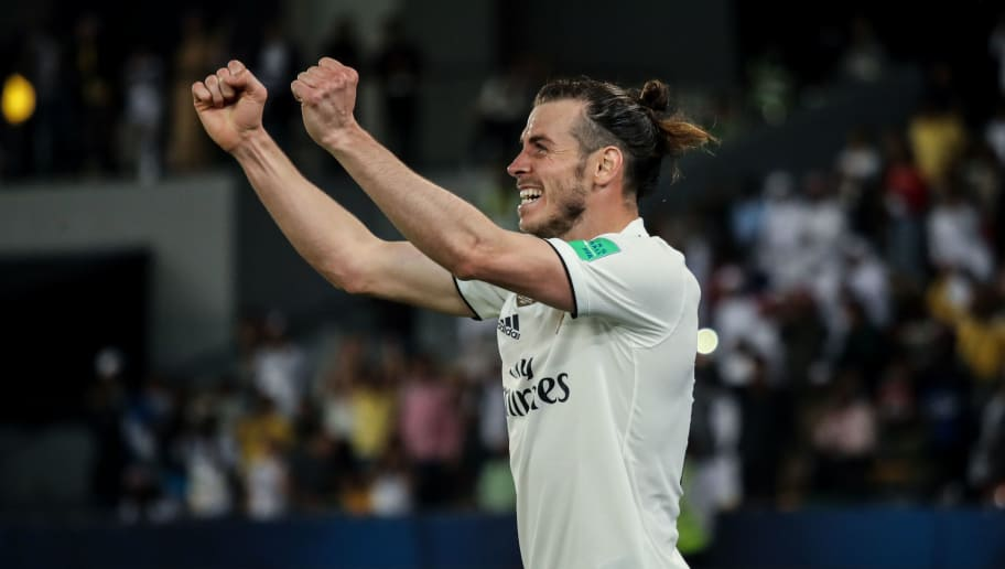 ABU DHABI, UNITED ARAB EMIRATES - DECEMBER 19: Gareth Bale of Real Madrid celebrates after scoring a goal to make it 0-3 during the FIFA Club World Cup UAE 2018 Semi Final match between Kashima Antlers and Real Madrid at Sheikh Zayed Sports City Stadium on December 19, 2018 in Abu Dhabi, United Arab Emirates. (Photo by Matthew Ashton - AMA/Getty Images)