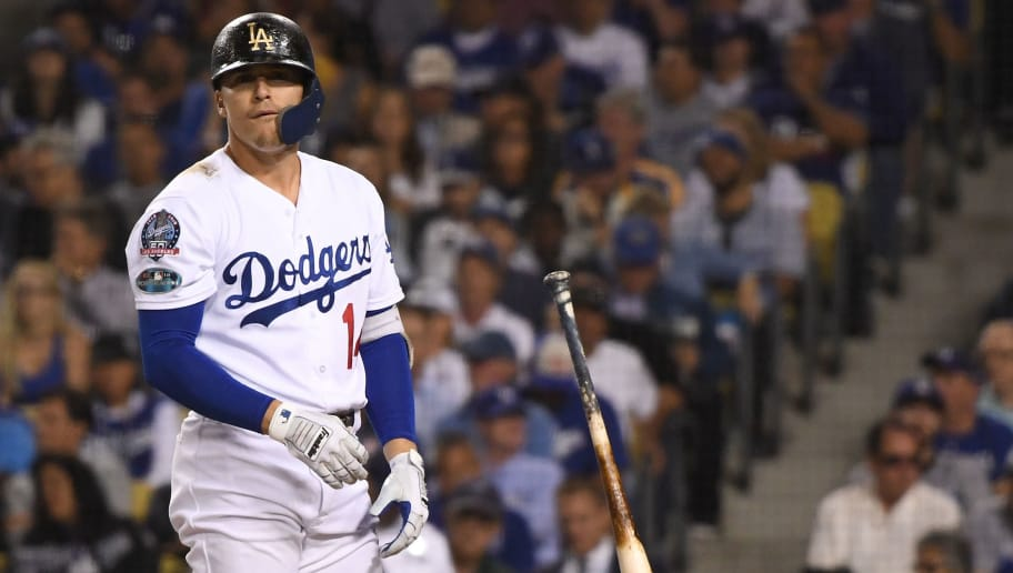 LOS ANGELES, CA - OCTOBER 15:  Enrique Hernandez #14 of the Los Angeles Dodgers reacts after striking out during the eighth inning against the Milwaukee Brewers in Game Three of the National League Championship Series at Dodger Stadium on October 15, 2018 in Los Angeles, California.  (Photo by Harry How/Getty Images)