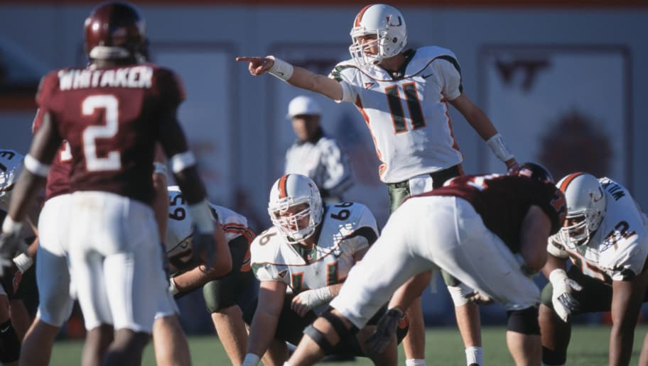 1 Dec 2001:  Quarterback Ken Dorsey #11 of the Miami Hurricanes calls a play as his teammate Brett Romberg #66 prepares to snap the ball during the NCAA game against the Virginia Tech Hokies at Lane Stadium in Blacksburg, Virginia.  Miami defeated Virginia Tech 26-24.  Mandatory Credit:  Criag Jones/Getty Images