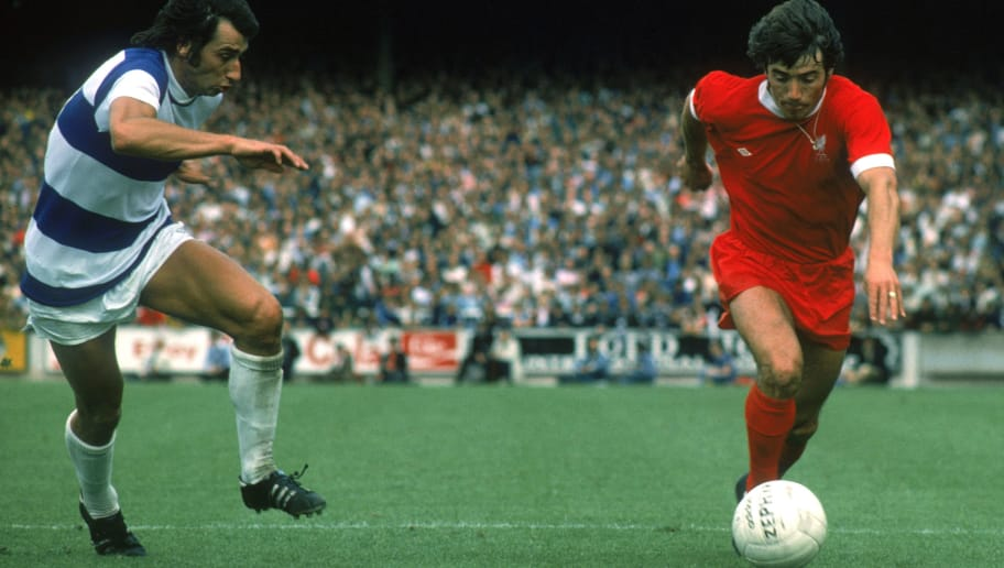 LONDON - AUGUST 16:  Kevin Keegan of Liverpool looks to take the ball past Dave Clement of Queens Park Rangers during the League Division One match held on August 16, 1975 at Loftus Road, in London. Queens Park Rangers won the match 2-0. (Photo by Don Morley/Getty Images)