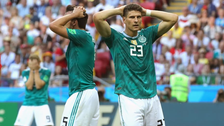 KAZAN, RUSSIA - JUNE 27: (L-R) Timo Werner of Germany, Mats Hummels  and his team mate Mario Gomez react during the 2018 FIFA World Cup Russia group F match between Korea Republic and Germany at Kazan Arena on June 27, 2018 in Kazan, Russia.  (Photo by Alexander Hassenstein/Getty Images, )