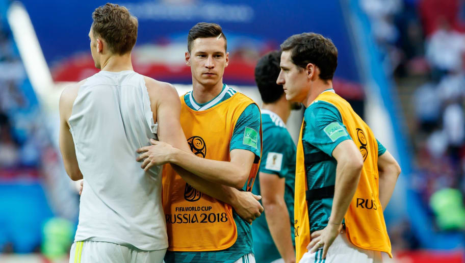 KAZAN, RUSSIA - JUNE 27: Goalkeeper Manuel Neuer of Germany, Julian Draxler of Germany and Sebastian Rudy of Germany look dejected after the 2018 FIFA World Cup Russia group F match between Korea Republic and Germany at Kazan Arena on June 27, 2018 in Kazan, Russia. (Photo by TF-Images/Getty Images)
