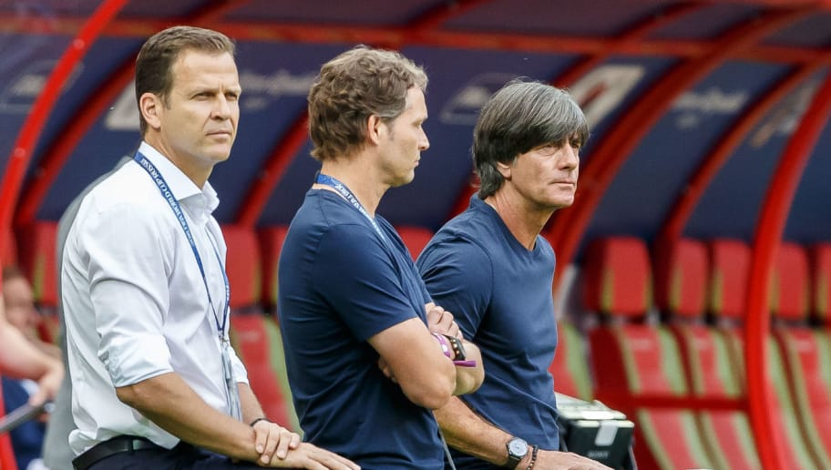 KAZAN, RUSSIA - JUNE 27: Manager Oliver Bierhoff of Germany, Assistant coach Marcus Sorg of Germany and Head coach Joachim Loew of Germany look on prior to the 2018 FIFA World Cup Russia group F match between Korea Republic and Germany at Kazan Arena on June 27, 2018 in Kazan, Russia. (Photo by TF-Images/Getty Images)