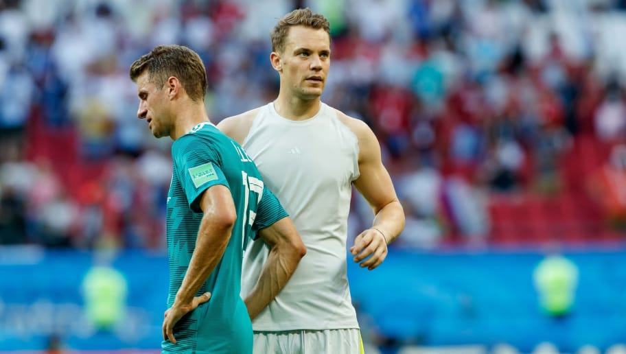 KAZAN, RUSSIA - JUNE 27: Thomas Mueller of Germany and Goalkeeper Manuel Neuer of Germany look dejected after the 2018 FIFA World Cup Russia group F match between Korea Republic and Germany at Kazan Arena on June 27, 2018 in Kazan, Russia. (Photo by TF-Images/Getty Images)