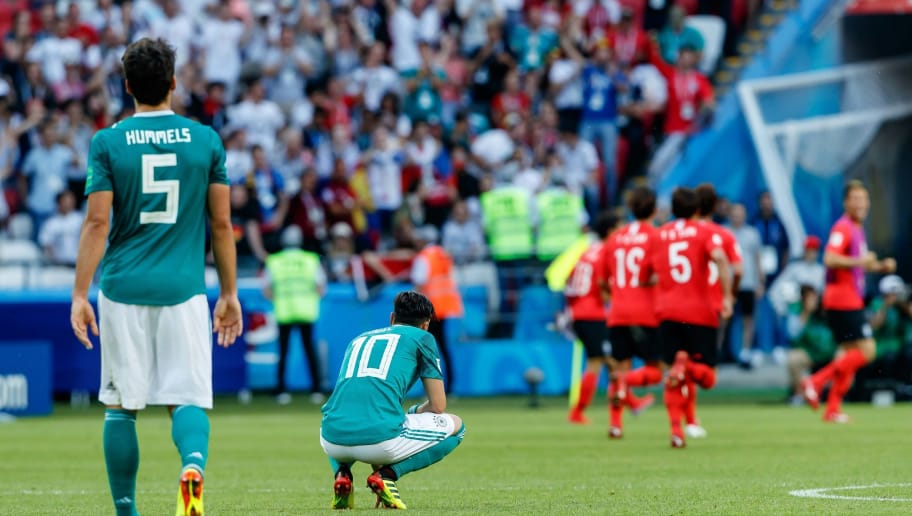 KAZAN, RUSSIA - JUNE 27: Mats Hummels of Germany and Mesut Oezil of Germany look dejected during the 2018 FIFA World Cup Russia group F match between Korea Republic and Germany at Kazan Arena on June 27, 2018 in Kazan, Russia. (Photo by TF-Images/Getty Images)