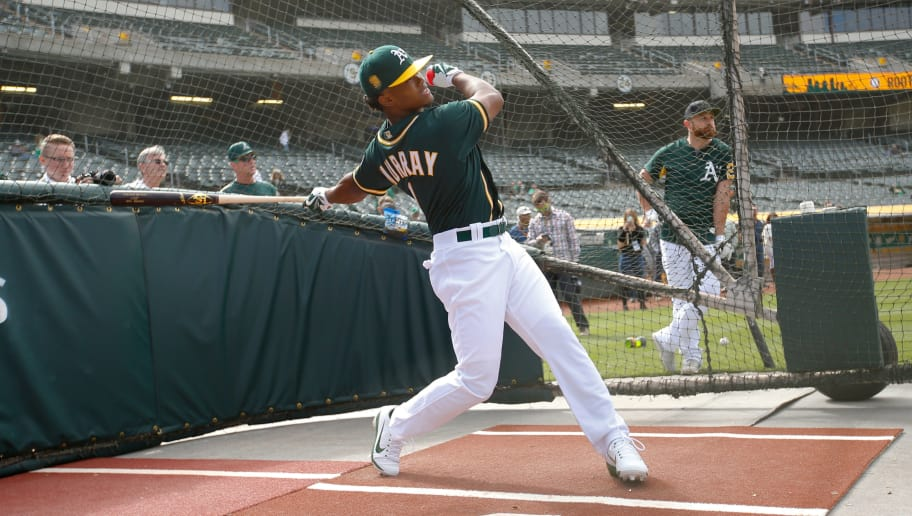 OAKLAND, CA - JUNE 15: First round draft pick Kyler Murray of the Oakland Athletics takes batting practice after signing his contract at the Oakland Alameda Coliseum on June 15, 2018 in Oakland, California. (Photo by Michael Zagaris/Oakland Athletics/Getty Images)